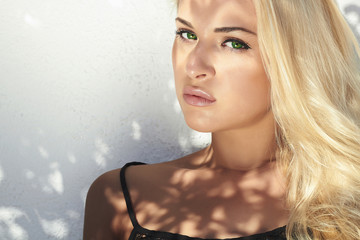 fashion portrait of beautiful blond woman in daylight.summer