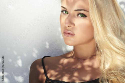 fashion portrait of beautiful blond woman in daylight.summer