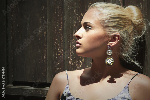 Beautiful blond woman near wooden door.beauty girl
