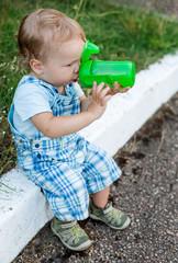 cute toddler boy drinking water
