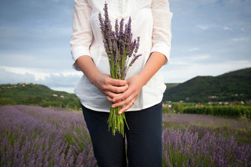 Woman holding lavander flowers