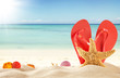canvas print picture - Summer beach with red sandals and shells