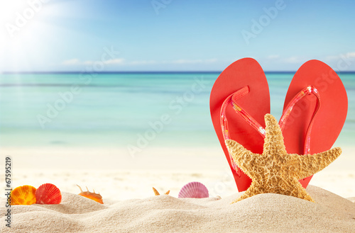 canvas print picture Summer beach with red sandals and shells