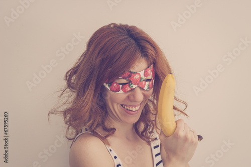 Superhero hipster girl wearing mask with banana gun Poster