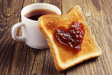 Cup of tea and toast bread with jam