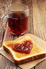 Tea and toast bread with jam in shape of hearts