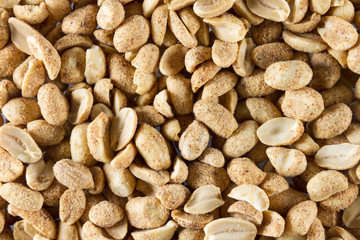 Dry roasted peanuts. scattered to make background or texture. Ma