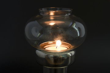 Candle flame in antique lamp