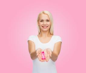 woman holding pink cancer awareness ribbon