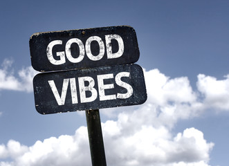 Good Vibes sign with clouds and sky background
