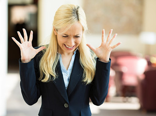 Stressed, screaming business woman in corporate office
