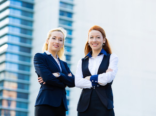 Two confident happy corporate business women