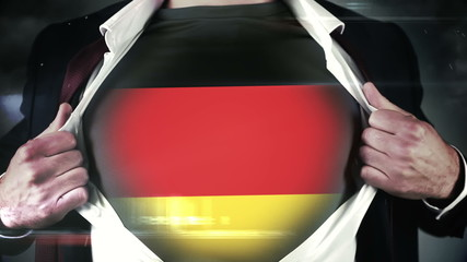 Businessman opening shirt to reveal german flag
