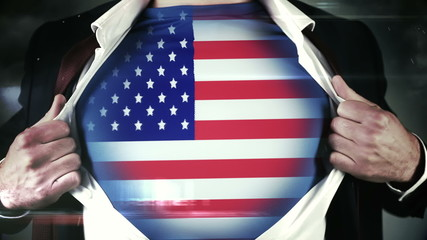 Businessman opening shirt to reveal USA flag