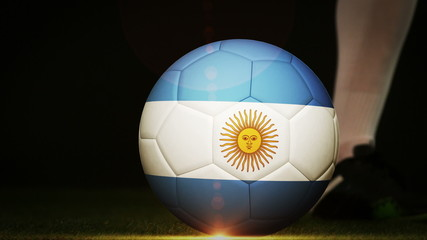 Football player kicking argentina flag ball