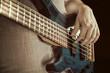 guitarist playing bas guitars, vintage image