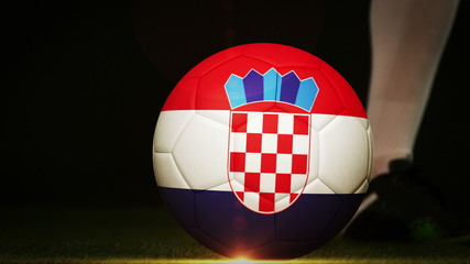 Football player kicking croatia flag ball