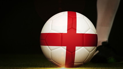 Football player kicking england flag ball