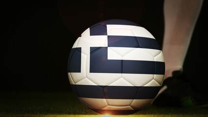 Football player kicking greece flag ball