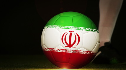 Football player kicking iran flag ball