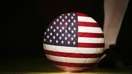 Football player kicking usa flag ball