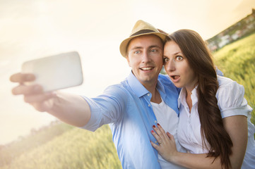 Pregnant couple taking selfie