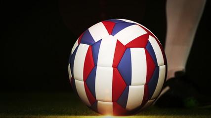 Football player kicking france flag ball