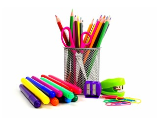 Colorful group of school supplies over a white background