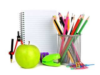 Blank lined notebook with colorful school supplies