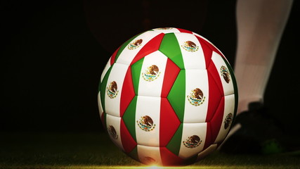 Football player kicking mexico flag ball