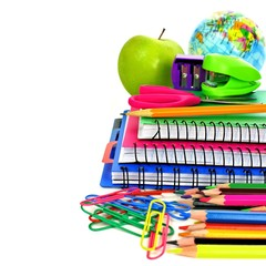 Group of colorful school supplies forming a border
