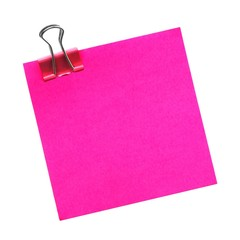 Blank pink post it note with paper clip isolated on white