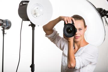 Pretty, female pro photographer with digital camera