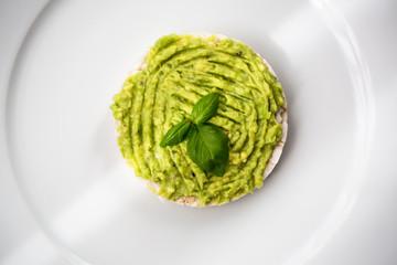 Fresh avocado guacamole on rice bred with basil