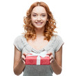 young casual woman hoding christmas gift