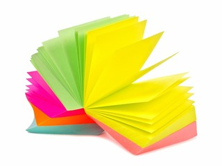 Note pad of sticky notes open like an fan isolated on white