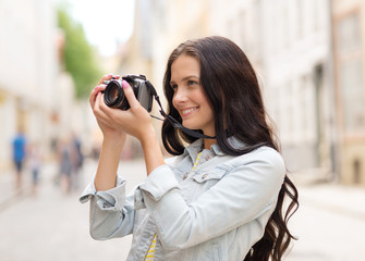 smiling teenage girl with camera