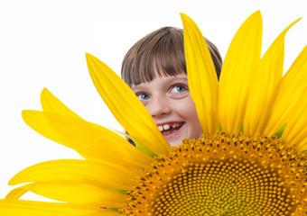 happly little gir and a sunflower