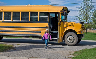 girl getting off a school bus