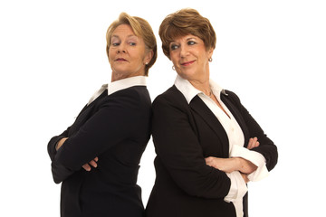 Two Mature Business Women Back to Back