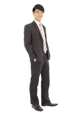 young businessman standing and hands on pocket.