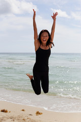 Stock image happy woman leaping with arms outstretched