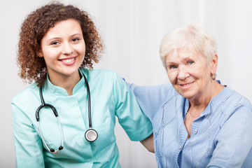 Nurse caring about senior lady