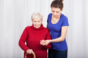 Granddaughter helping grandmother