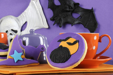 Happy Halloween cookies with pumpkin and flying bats