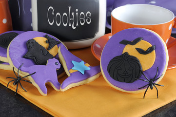 Happy Halloween cookies with spiders and cookie jar - close up.