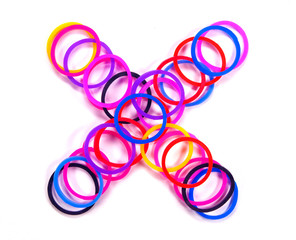 Colorful rubber band multiply symbol.