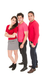 two men and a young girl dressed in red posing