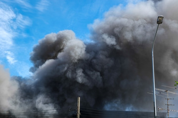 Black smoke and blue sky