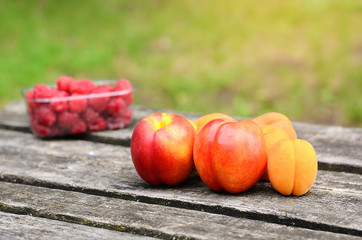 Fresh fruits on a wooden board after harvest